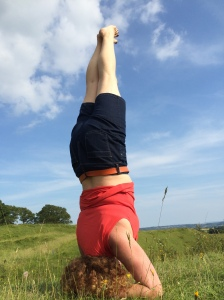 Lara in a yoga headstand in the great outdoors