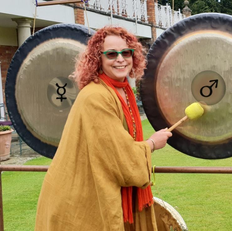 Lara-playing-gongs